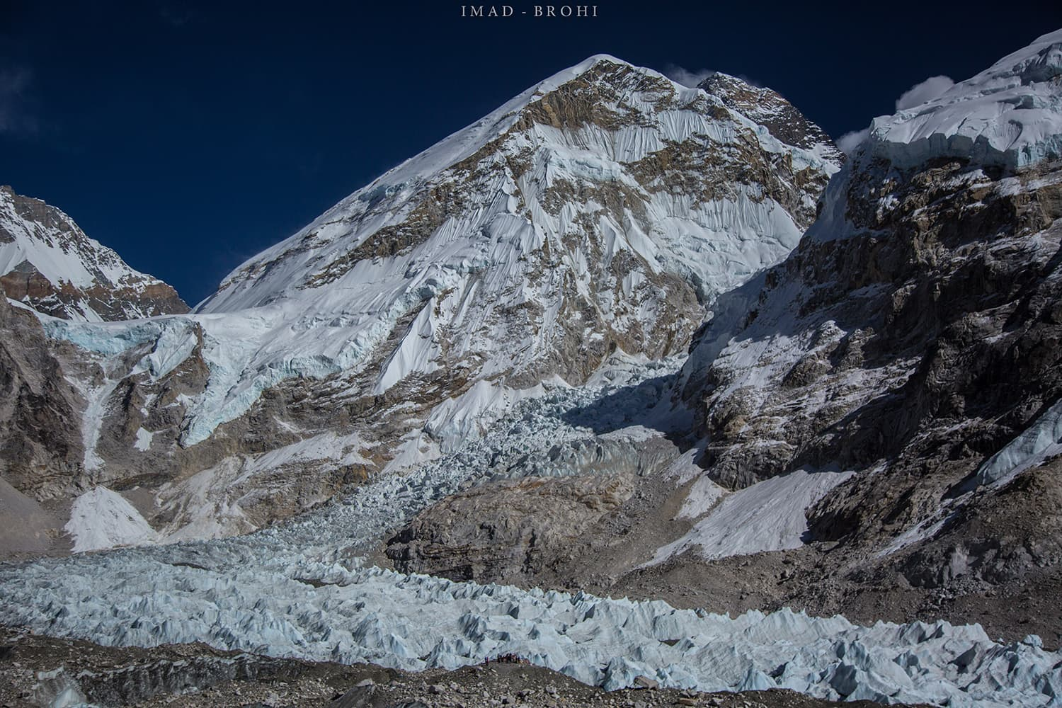Day 9: People gather at Mount Everest Base Camp along the side of Khumbu Glacier. The glacier between Lho La and Nuptse is the Khumbu Icefall, the first step and a daunting one for those climbing Mount Everest.