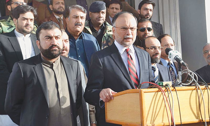 Federal Interior Minister Ahsan Iqbal talks to the media after inaugurating the executive passport office on Thursday.—APP