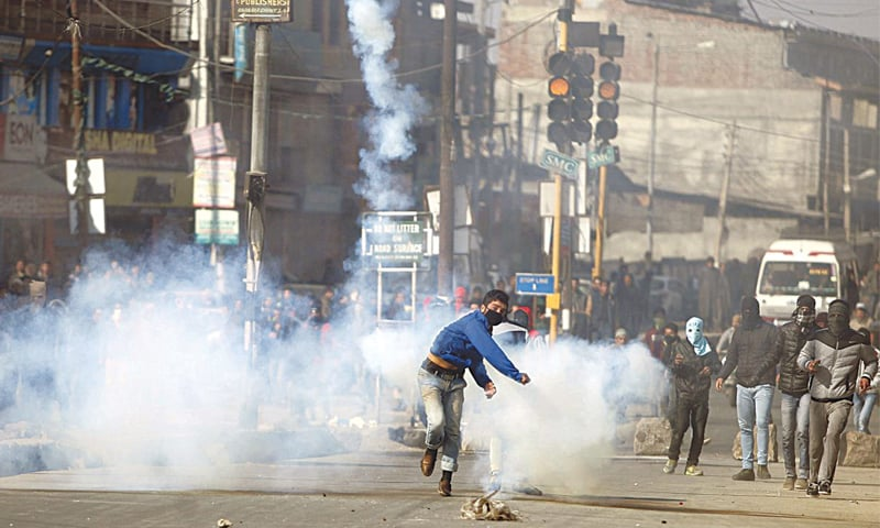 A Kashmiri demonstrator throws back a tear gas shell fired by Indian police during a protest in Srinagar, in Indian Kashmir, on February 5, 2016. The demonstrators said they were demanding an end to Indian rule in Kashmir | Danish Ismail /Reuters