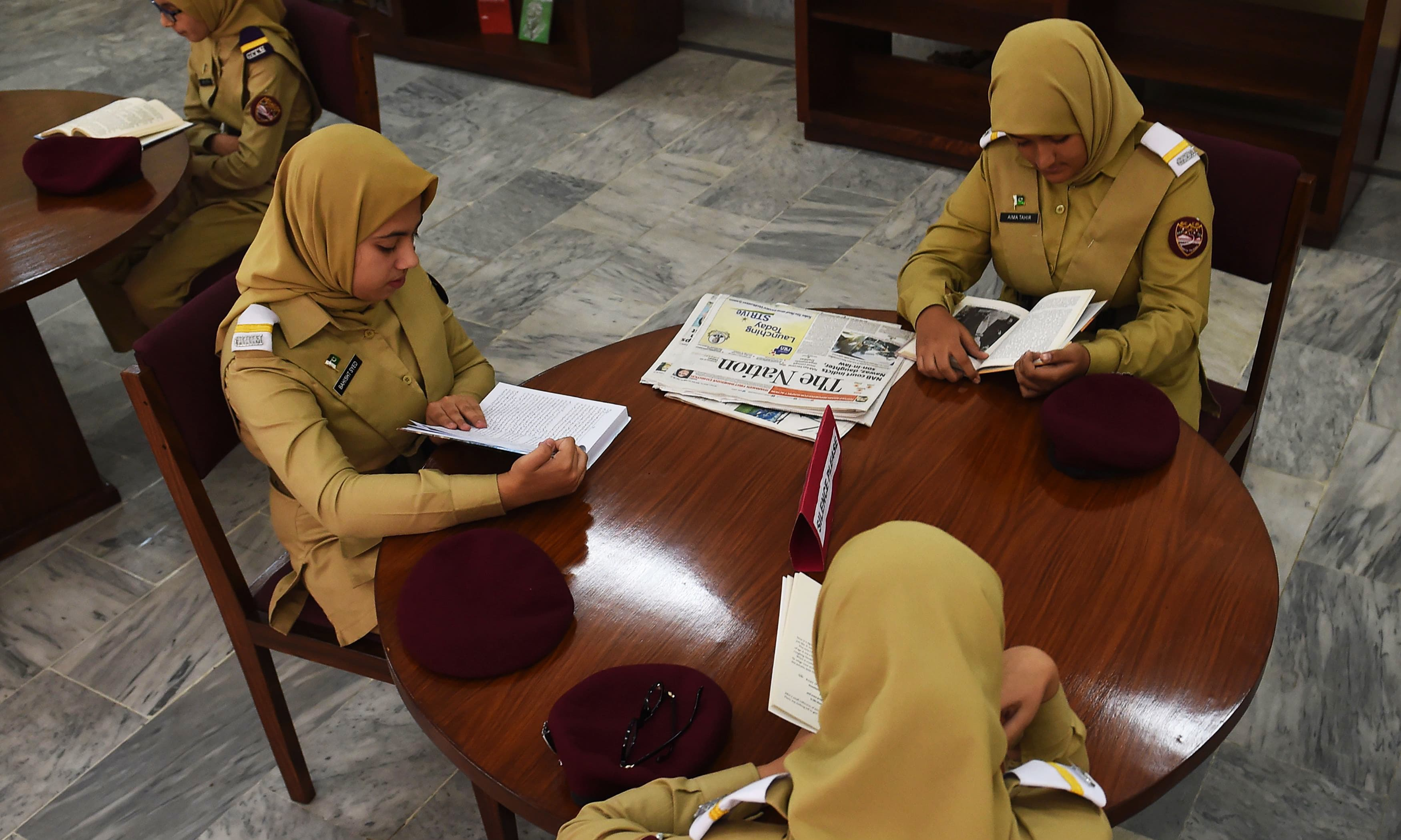 Cadets read books at the college library. —AFP