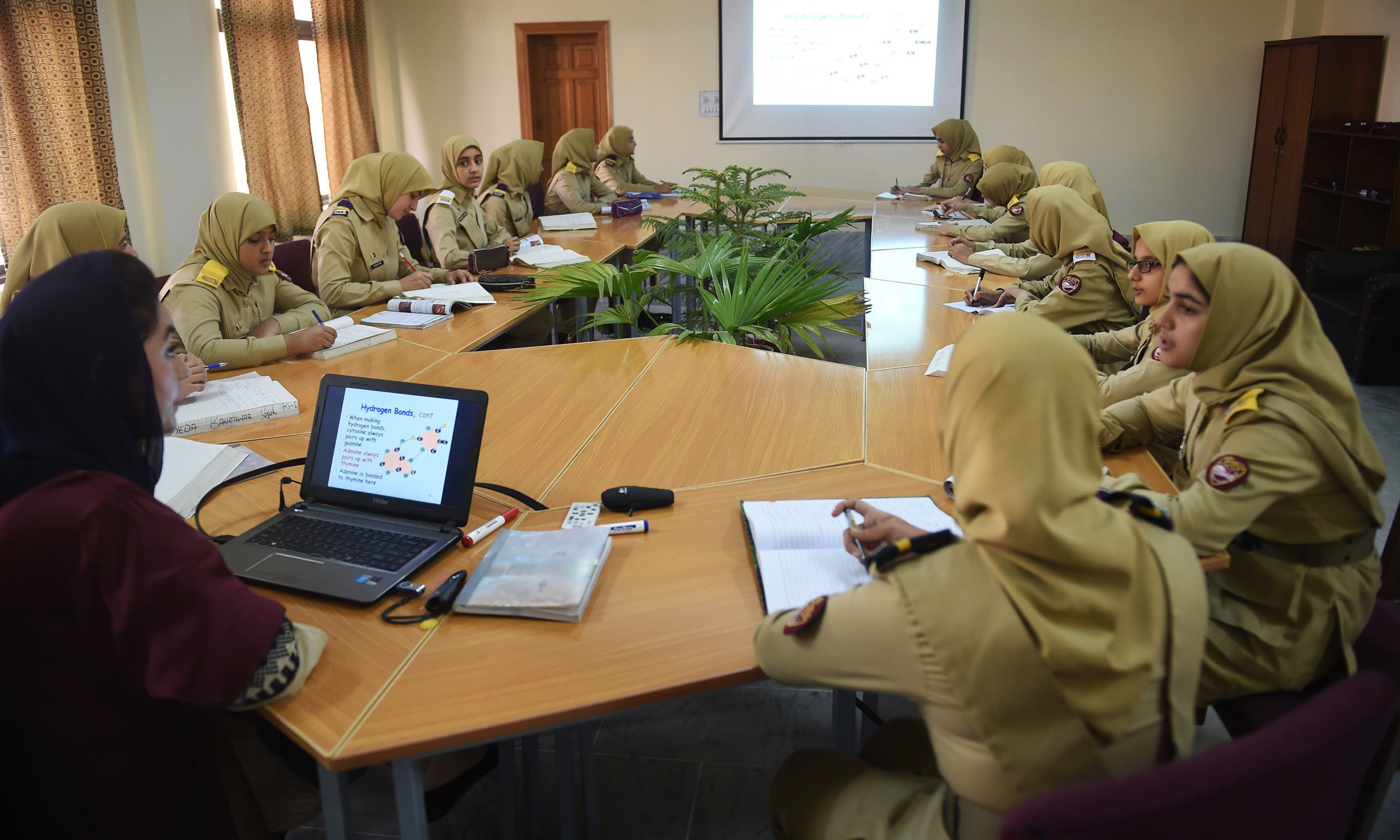 Girls attend a lecture at the cadet college. —AFP