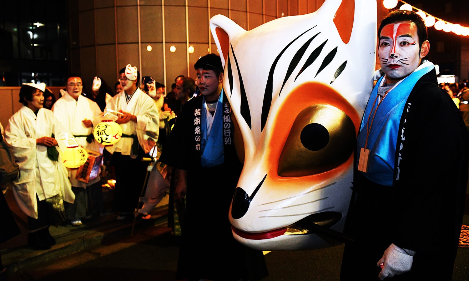 Residents in fox makeup participate in the Oji Fox parade to thank the outgoing and welcome the incoming year in Tokyo, Japan.—AFP