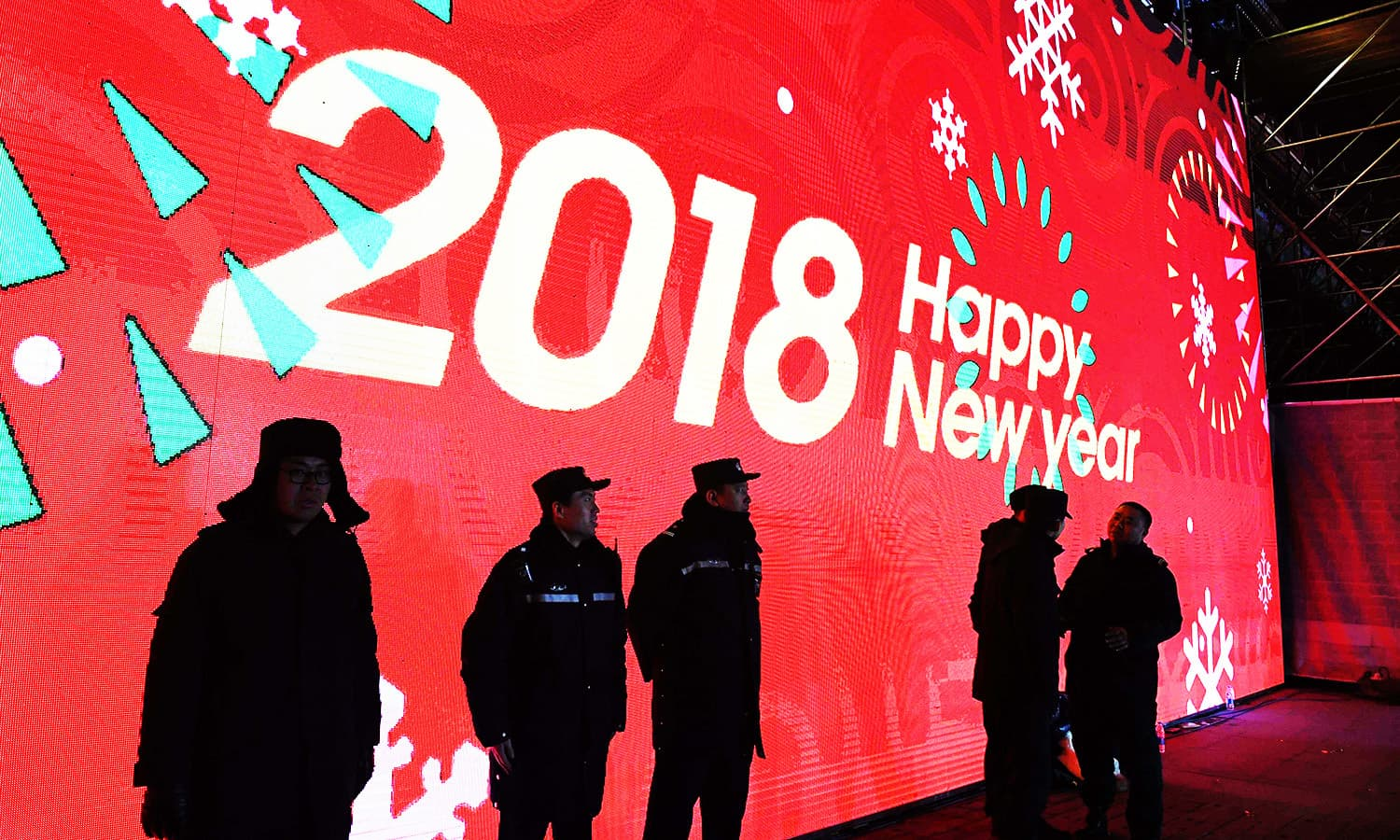 Policemen stand guard at a countdown event marking the arrival of the New Year in Beijing, China.—AFP
