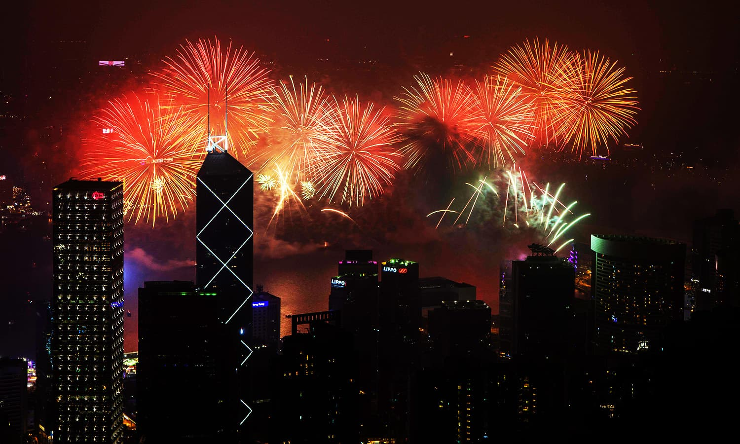 Fireworks explode over Victoria Harbour in Hong Kong.— AFP
