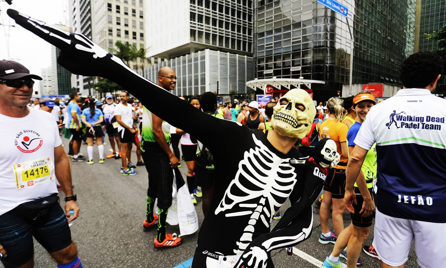 A runner dressed as a skeleton poses for a photo prior to the start of the Sao Silvestre race in Sao Paulo, Brazil, on New Year's Eve.—AP