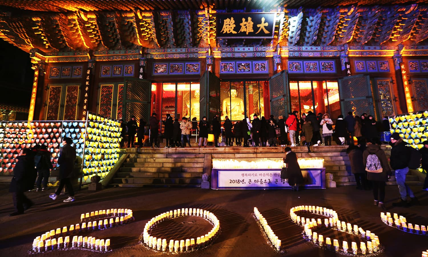 Buddhists light candles during New Year celebrations at Jogyesa Buddhist temple in Seoul, South Korea.—AP