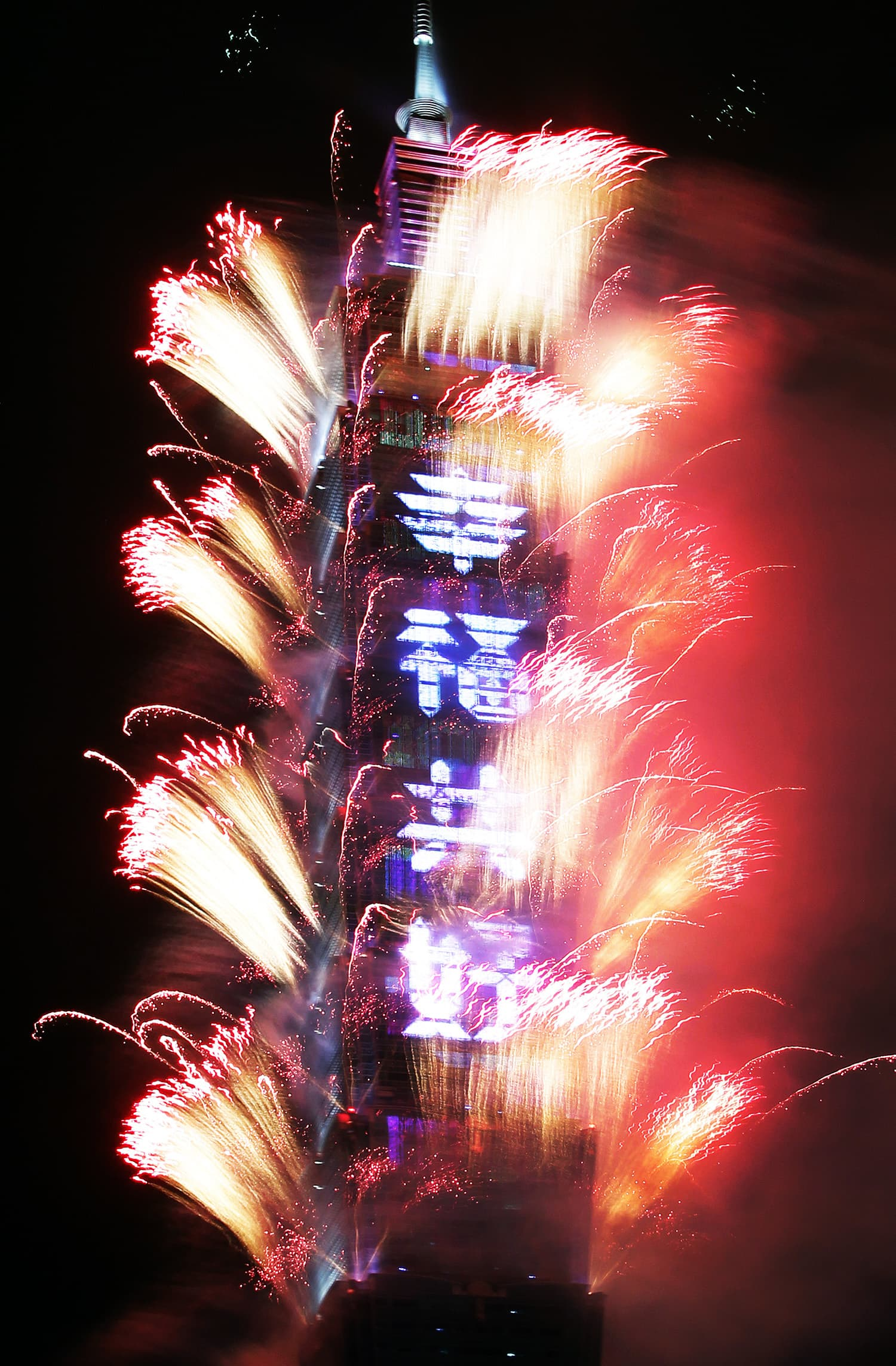 "Fireworks explode with slogan reading ""Happiness and Good Condition Together"" on the Taipei 101 building during the New Year's celebrations in Taipei, Taiwan.—AP"