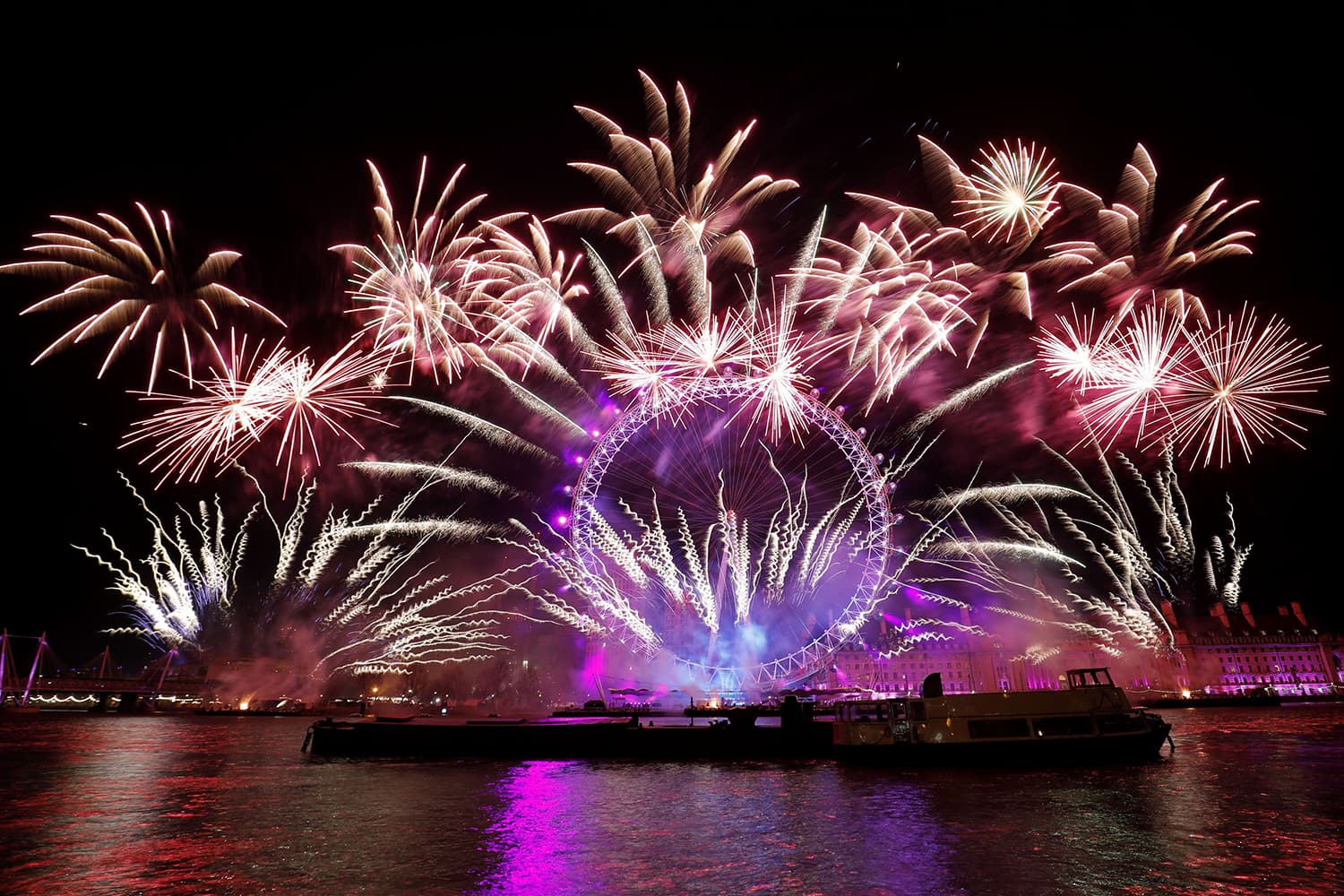 Fireworks explode around the London Eye during New Year's celebrations in central London just after midnight. — AFP