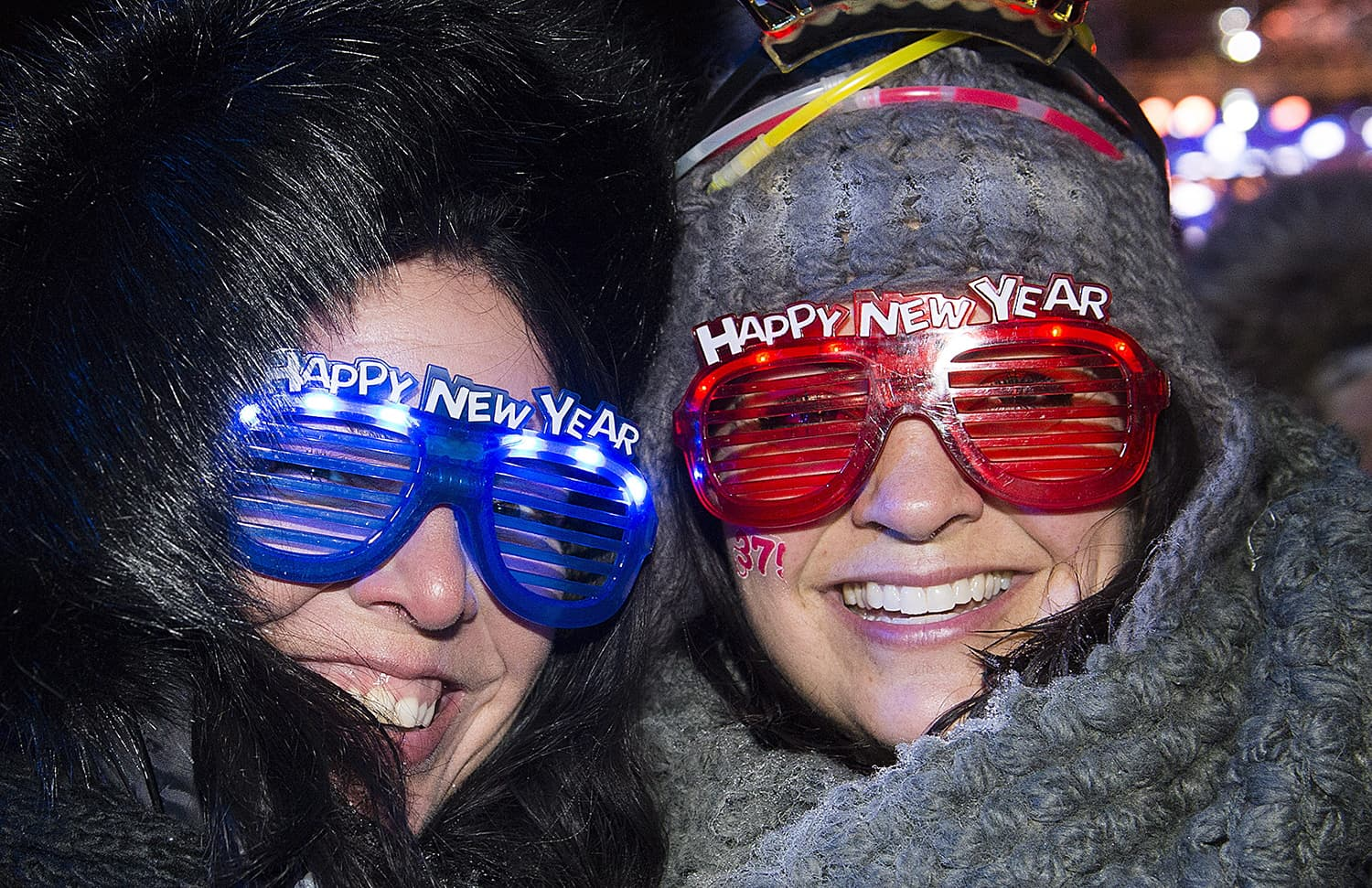 Two women smile during New Year's Eve celebrations in Montreal, Canada, Sunday, Dec. 31, 2017. — AP