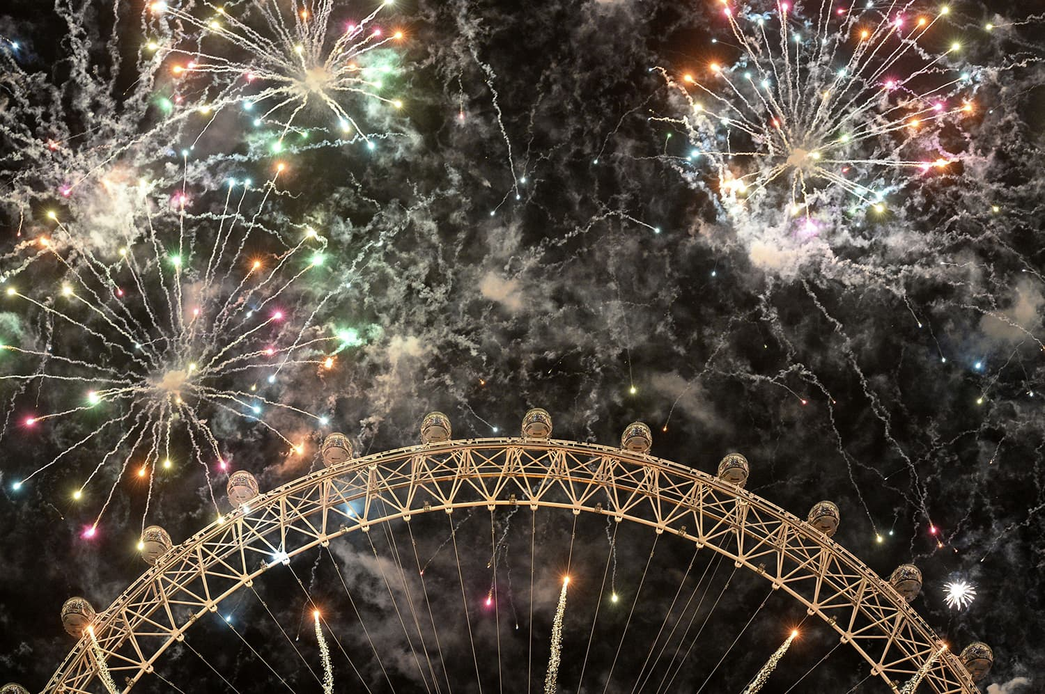 Fireworks light up the sky over the London Eye in central London during the New Year celebrations. — AFP