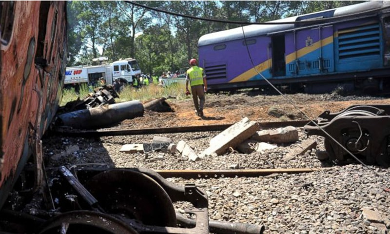 Ruined carriages at the scene of a train accident near Kroonstad, South Africa.—AP