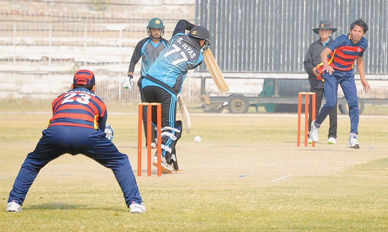 HYDERABAD: Wapda paceman Mohammad Asif bowls during the National One-day Cup match against PTV at the Niaz Stadium on Friday.—INP