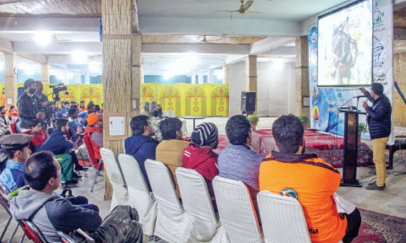 A speaker shares information about the trekking's advantages during the Swat Annual Trekkers Meetup in Mingora. — Dawn