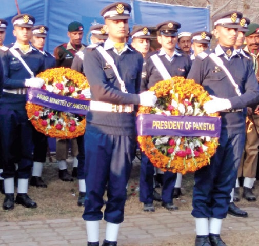 The cadets of PAF Academy Risalpur lay wreaths on the grave of retired Air Marshal Asghar Khan in Abbottabad. — Dawn