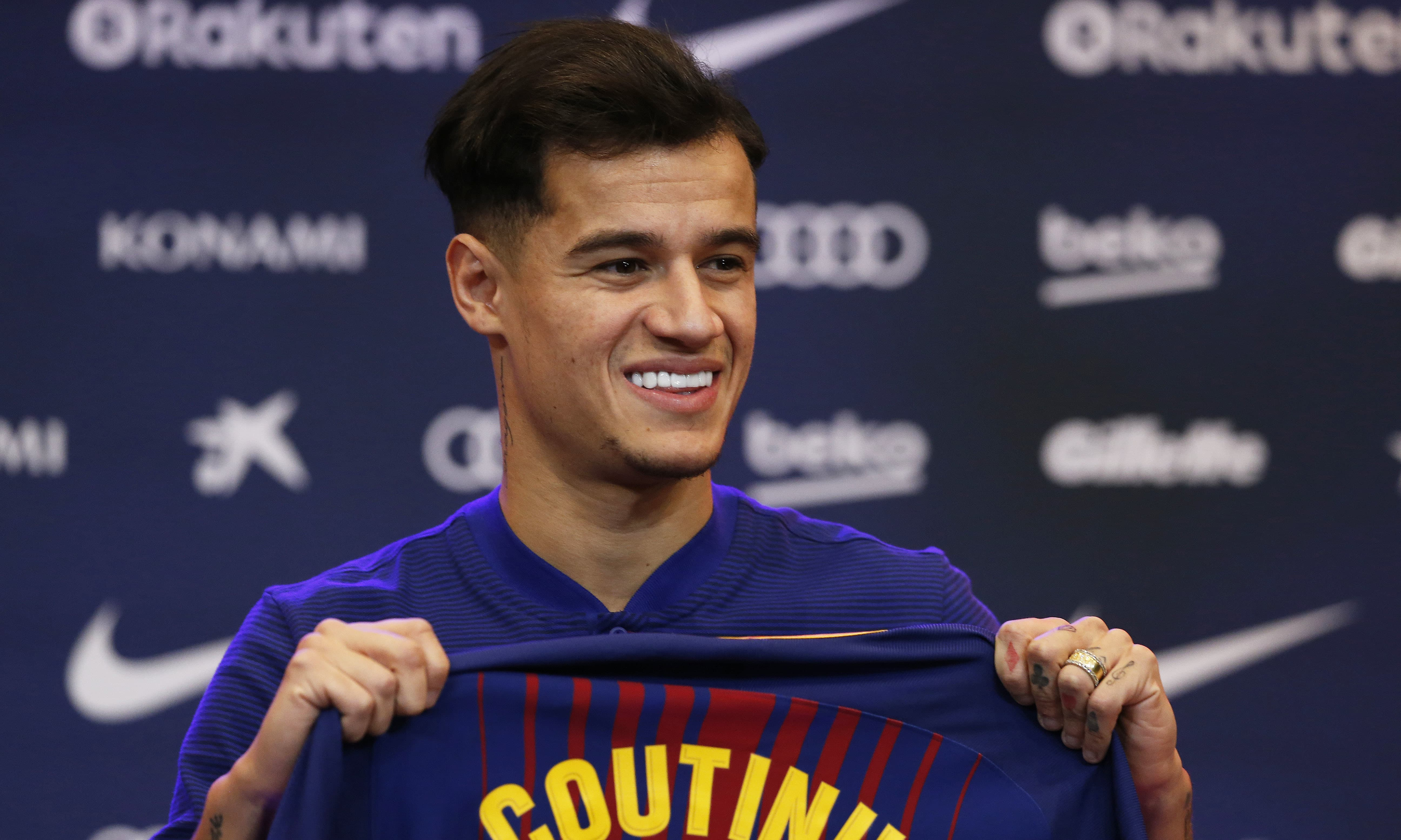 b7c0a16ec19 Barcelona  39 s new signing Brazilian Philippe Coutinho poses for the  media