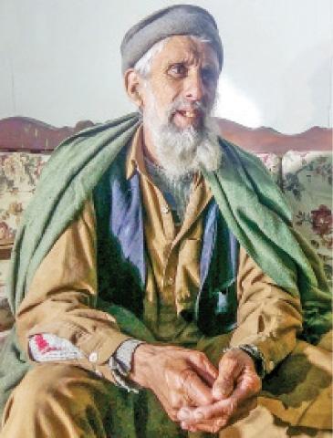 Rahim Gul, one of the three last men who speak Badeshi language in Swat. — Dawn