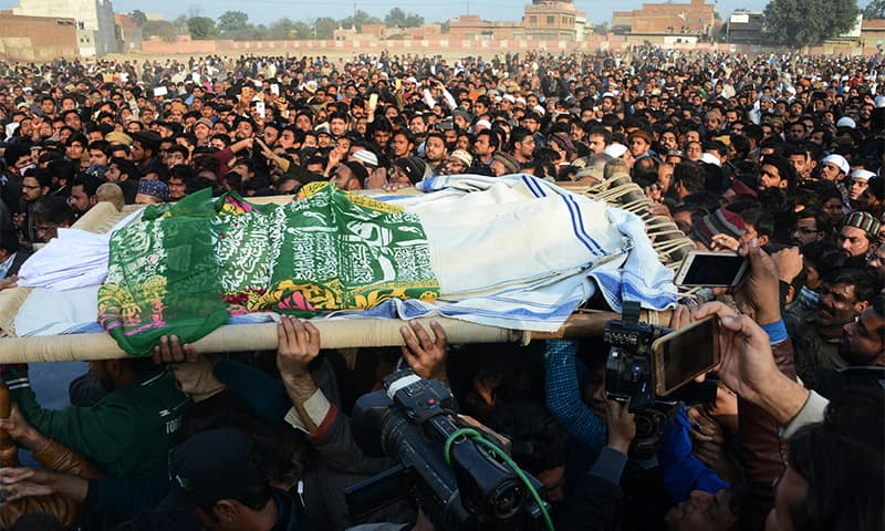 Residents carry Zainab's body during her funeral in Kasur.— AFP