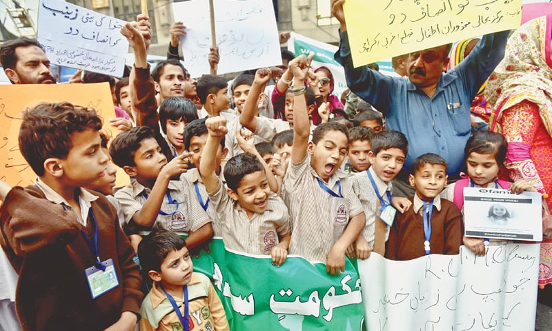 Young deaf and mute students protest the brutal rape and murder of little Zainab outside the Karachi Press Club on Thursday.  —Fahim Siddiqi / White Star