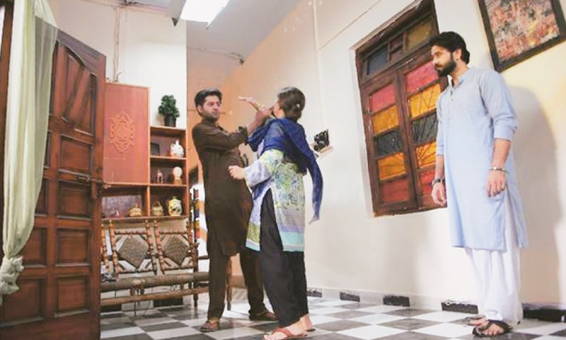 This photograph taken on Oct 18, 2017 shows performers Rubina Ashraf, Ali Abbas (right) and Imran Ashraf taking part in the filming of a scene during the shooting of drama serial Mein Maa Nahi Banna Chahti (I don't want to become a mother) in Karachi.—AFP