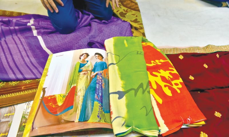 Indian catalogues and saris imported on order. / Photos by Fahim Siddiqi / White Star
