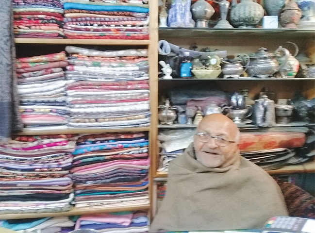 OCTOGENARIAN Gurdhan Das in his shawls shop in Islamabad.—Photo by writer