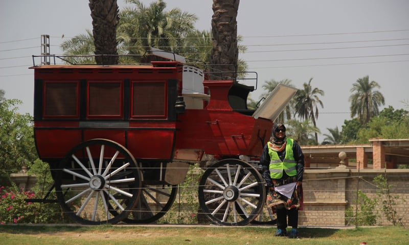 Ayesha stands with the royal carriage of the Nawab of Bahawalpur at Noor Mahal - Photos by Hammad Shakil