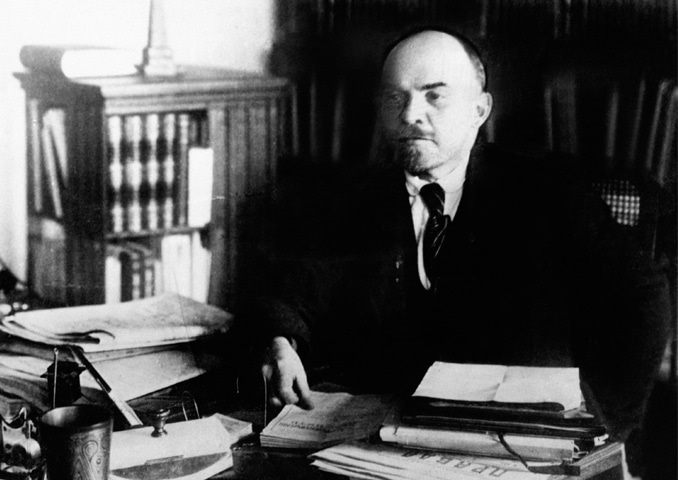 The Bolshevik [one of the majority] who overthrew the tsar: Vladimir Lenin at his desk, circa 1922