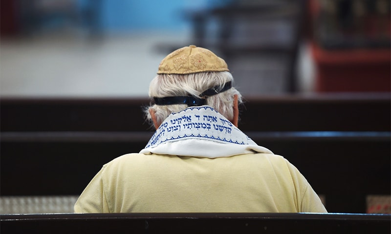 A member of the Indian Jewish community attends a morning prayer service at the Magen David Synagogue in Mumbai. ─ AFP
