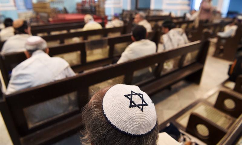Members of the Indian Jewish community attend a morning prayer service at the Magen David Synagogue in Mumbai. ─ AFP
