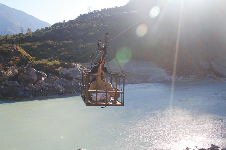 A MAN transports goods on a chairlift.—Photo by writer
