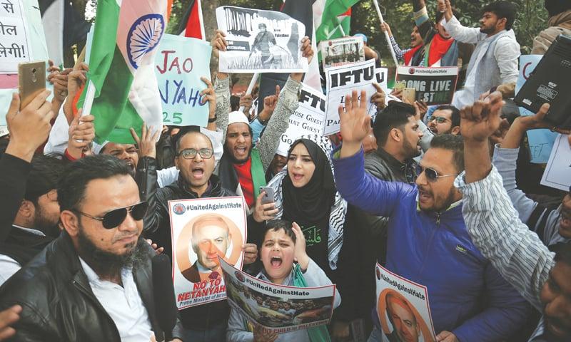 NEW DELHI: Civil rights activists protest against the visit of Israeli Prime Minister Benjamin Netanyahu near the Israeli embassy on Monday.—AP