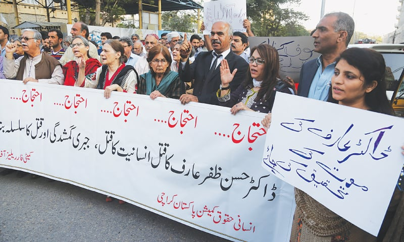 Rights activists and friends of Prof Hasan Zafar Arif hold a protest demonstration in front of the Karachi Press Club on Tuesday.—White Star