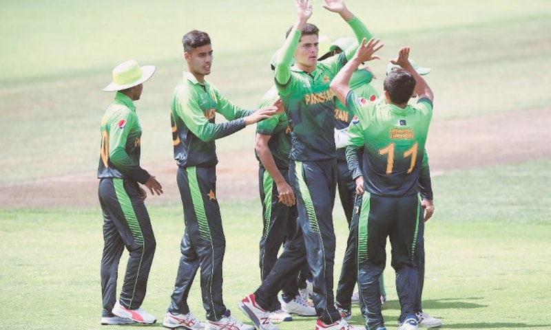 WHANGERAI: Pakistan's paceman Shaheen Shah Afridi (third L) celebrates with team-mates after taking another Ireland wicket in the ICC Under-19 World Cup match at Cobham Oval on Tuesday.—Courtesy ICC