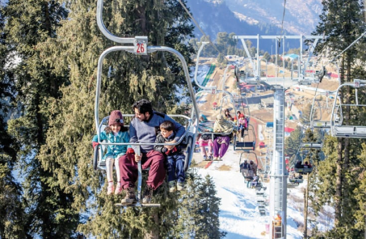 Tourists enjoy a ride on the chairlift. — Dawn