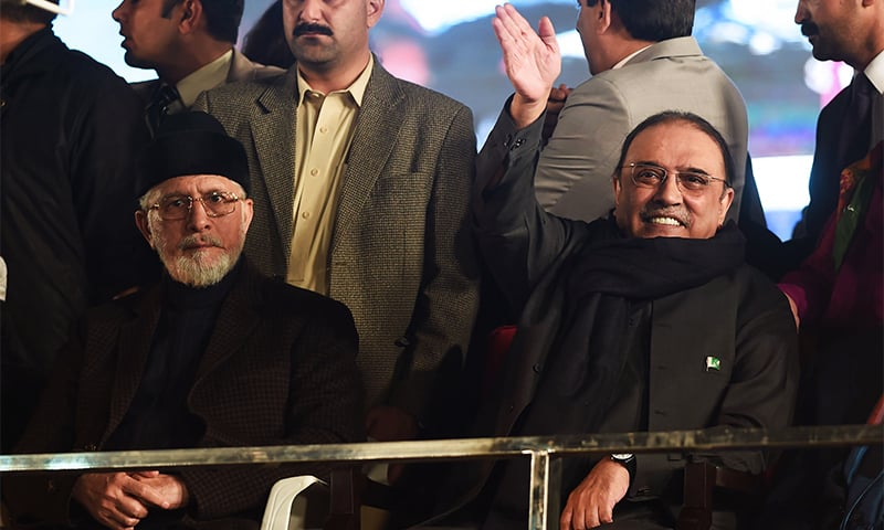Dr Tahirul Qadri and PPP co-chairman Asif Ali Zardari attend an anti-government protest rally in Lahore.— AFP