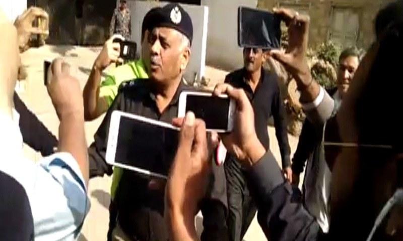 SSP Malir Rao Anwar talks to media on his way to DIG CTD's office.—DawnNews