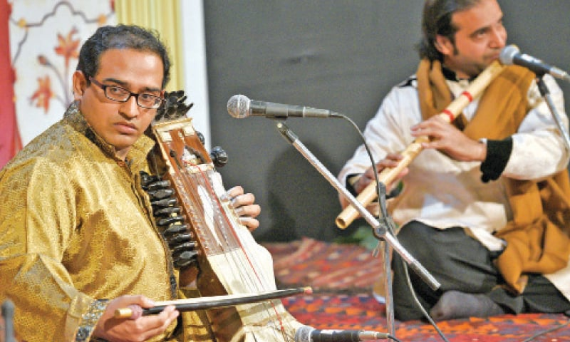 (L) Adnan Haider and Salman Adil perform at the event. — Photo by Tanveer Shahzad