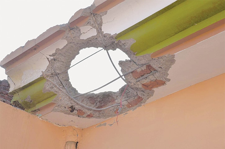 A DAMAGED portion of a house in a village along the Sialkot Working Boundary that was hit by a mortar shell fired by Indian troops on Saturday.—PPI
