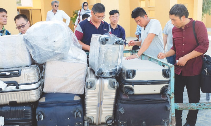 GWADAR: Chinese workers after arriving at Gwadar airport in this Oct 3, 2017 photo.—Reuters