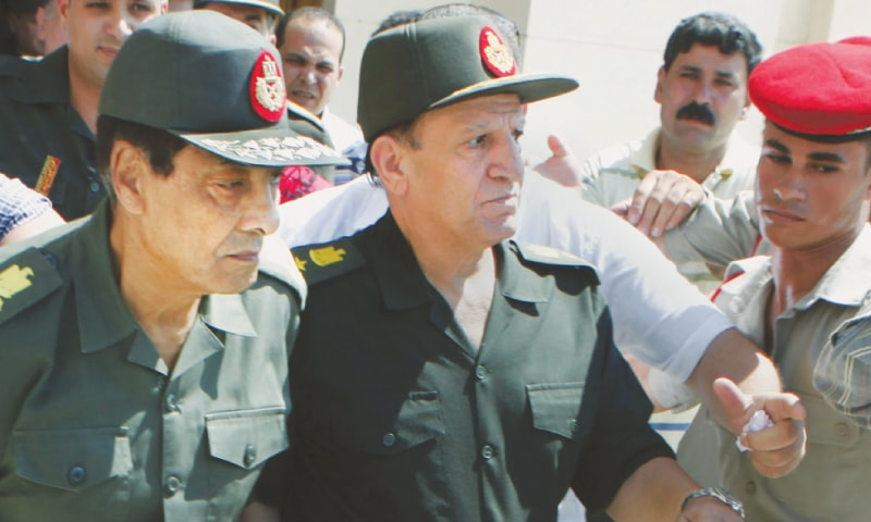 In this  Sept 16, 2011 file photo then military ruler field marshal Mohammed Hussein Tantawi (left) and Sami Annan, then Egyptian chief of staff of the armed forces, are surrounded by military policemen as they attend the funeral of Khaled Abdel Nasser, the son of Egypt's late president Gamal Abdel Nasser in Cairo.—AP