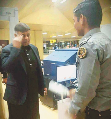 EX-MALIR SSP Rao Anwar at the FIA immigration counter of the Benazir Bhutto International Airport during his bid to leave the country on Tuesday.—Online