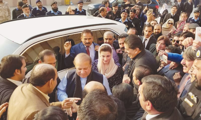 ISLAMABAD: Former prime minister Nawaz Sharif and his daughter Maryam Nawaz arrive at the National Accountability Bureau court for the hearing on Tuesday.—White Star