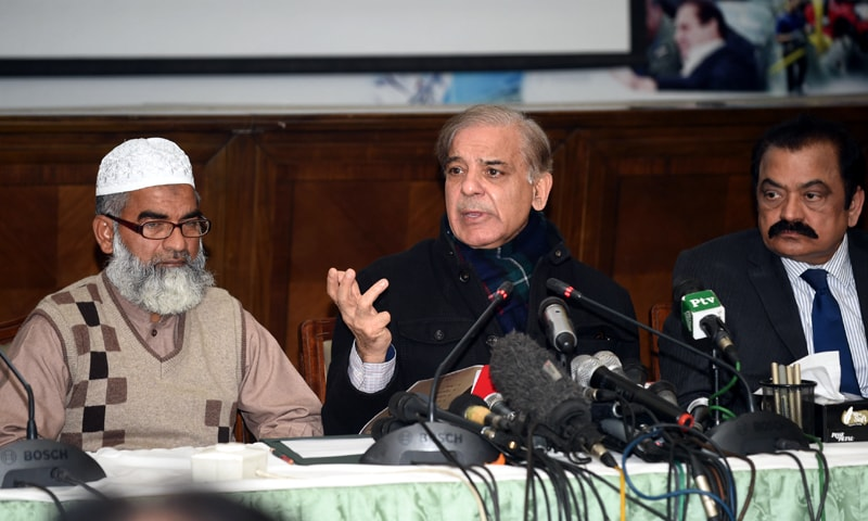 LAHORE: Punjab Chief Minister Shahbaz Sharif accompanied by Haji Mohammad Ameen, Zainab's father, addresses a press conference here on Tuesday.—M. Arif / White Star