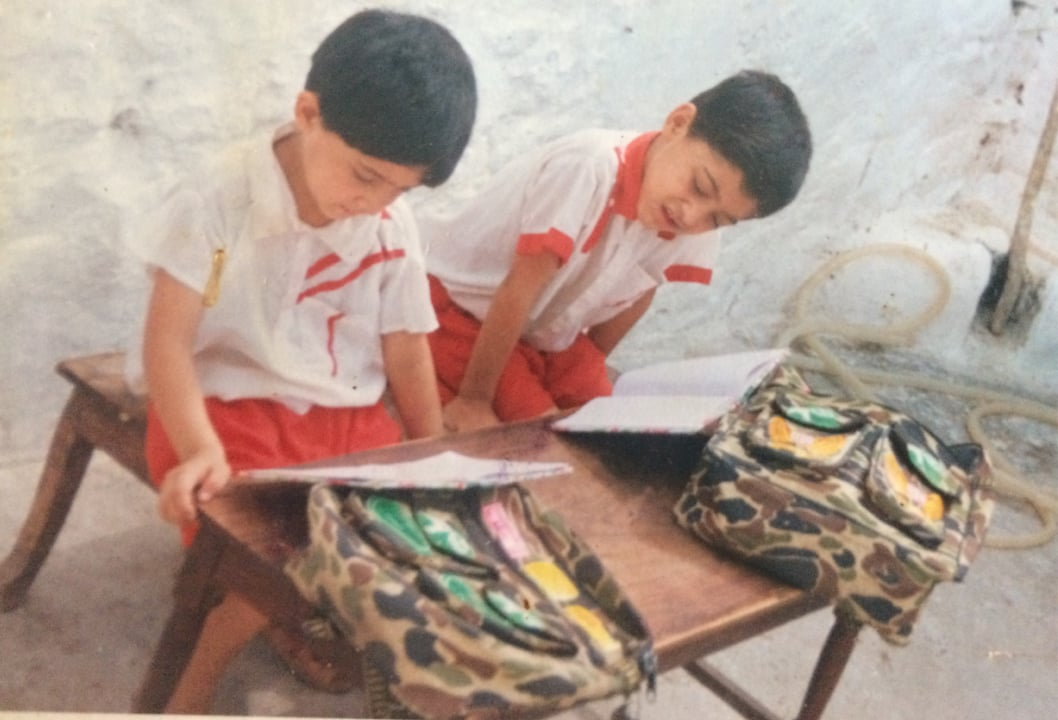 Mashal Khan (left) with his brother, doing homework at home