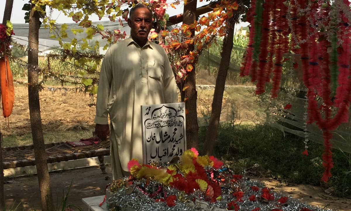 Iqbal Khan at his son's grave