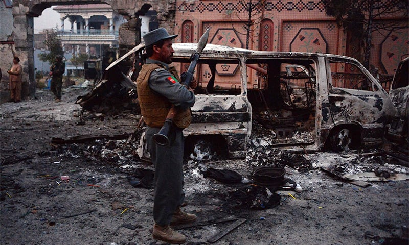 Afghan security forces inspect the site of attack on British charity Save the Children office.— AFP