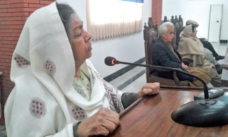 Senior Pashto writer Zaitoon Bano addresses the seminar at the University of Peshawar on Wednesday. — Dawn