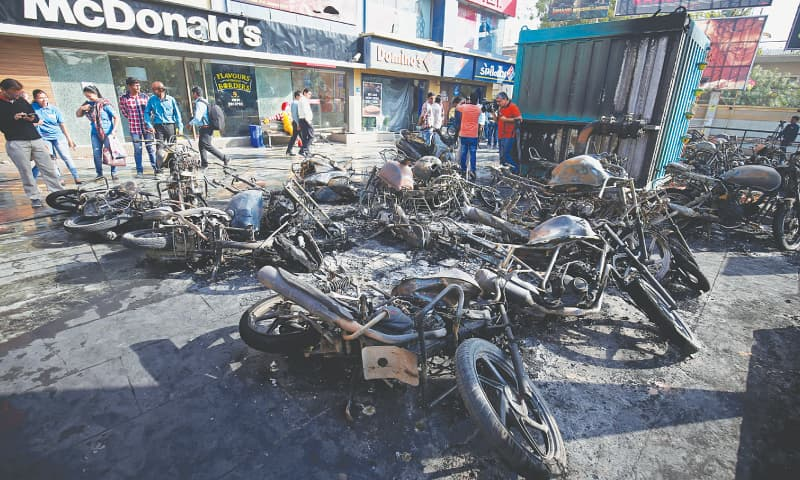 Ahmedabad: Vehicles set on fire outside a multiplex on Tuesday night following a protest by Rajputs against the release of the Bollywood movie, Padmaavat.—Reuters