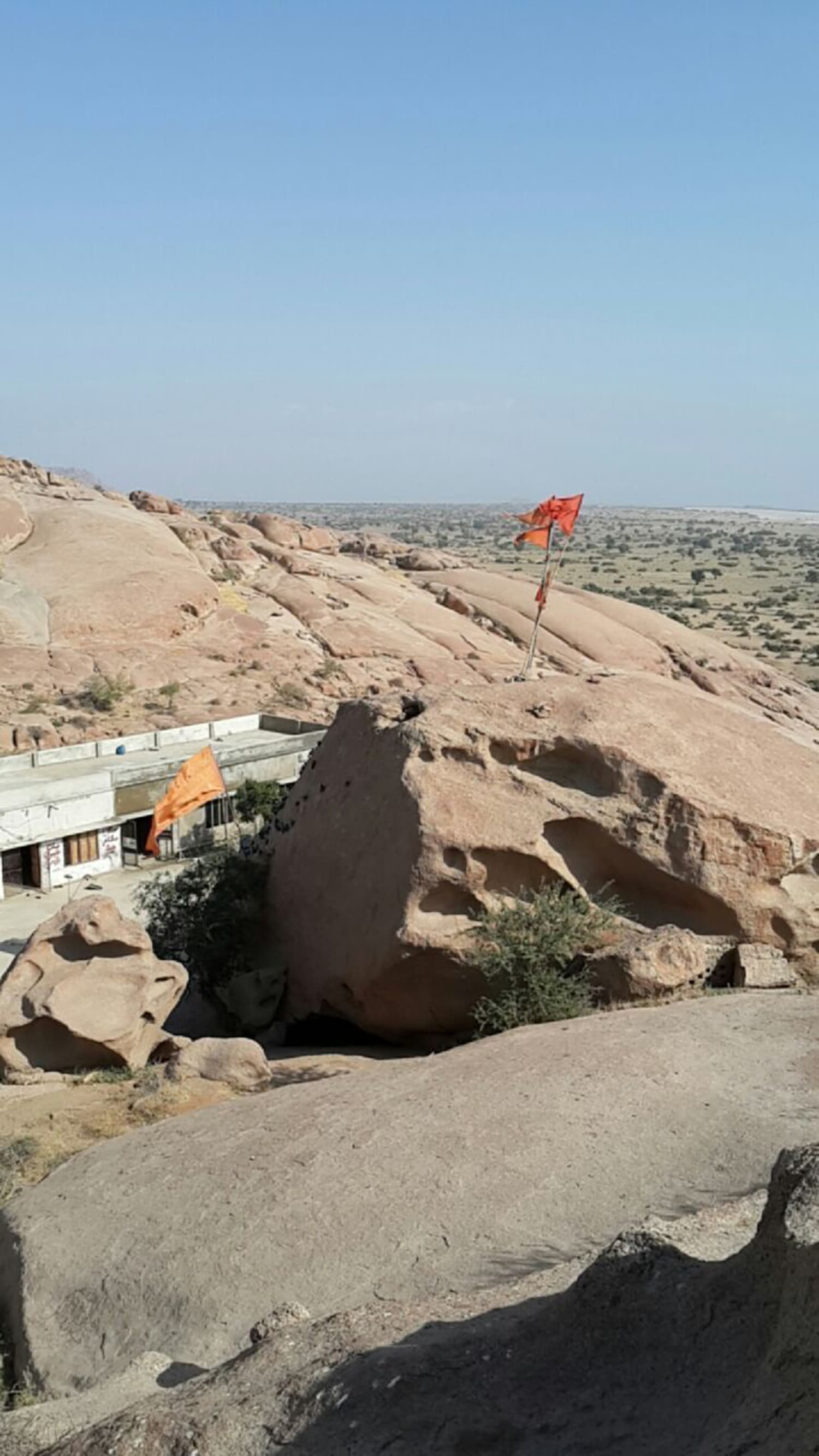 An aerial view of Kali temple, with the Indian landscape in the background.