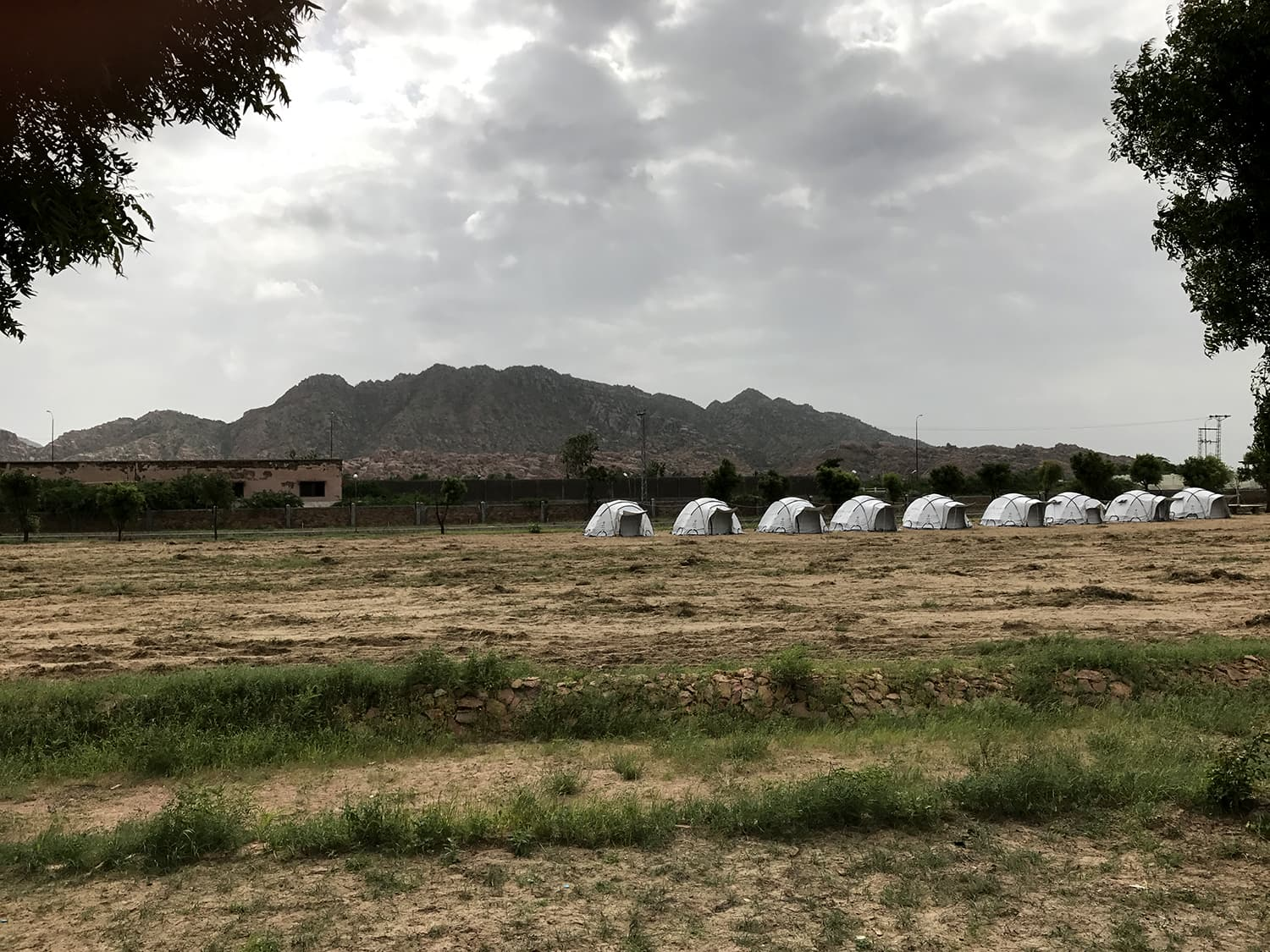A shot of the Karoonjhar ranges, from the Thardeep Rural Development Programme huts. Both solar-powered huts and camping tents (as seen here) are available on rent just outside Nagarparkar city.